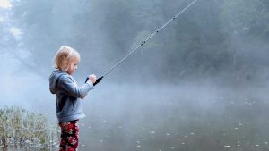 Taking Kids for Fishing - Kid with a fishing rod